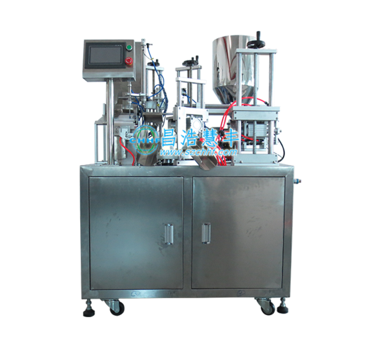 Automatic carousel filling and sealing machine