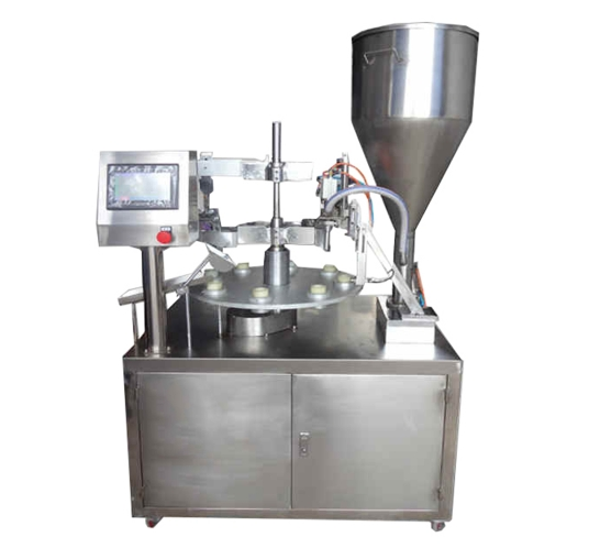 Semi - automatic carousel filling and sealing machine